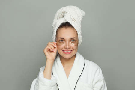 Pretty woman in cosmetic hydrogel eye patch. Facial treatment and skin care concept Banco de Imagens