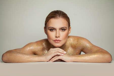 Fashion portrait of beautiful glamorous woman on white background