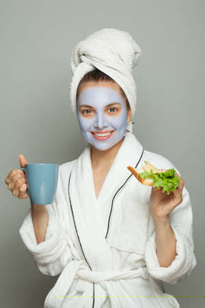 Spa woman in cosmetic face mask. Facial treatment and skin care concept Banco de Imagens