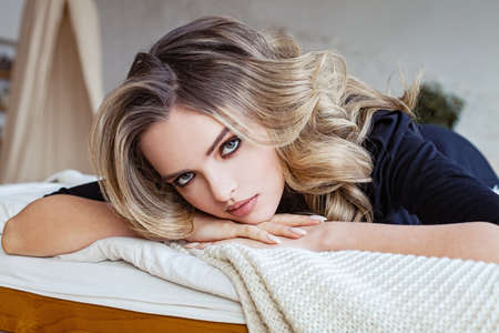 Perfect young woman resting on sofa at home