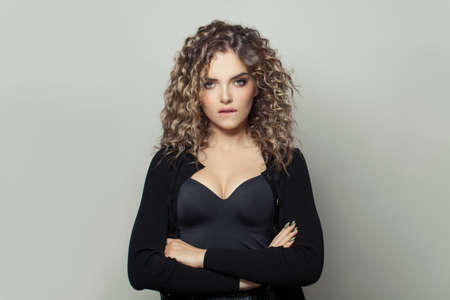 Smart woman with curly hairstyle on white background