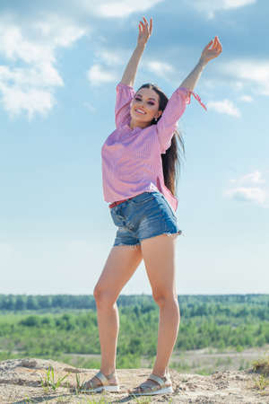 Happy young woman in summer day outdoors