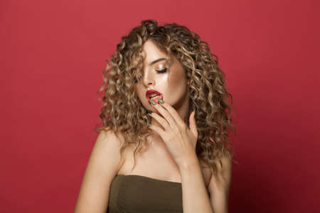 Attractive young woman with curly hair portrait Banco de Imagens