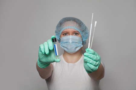 Medic doctor or nurse with Coronavirus test kit.