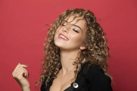 Excited young woman with curly hair