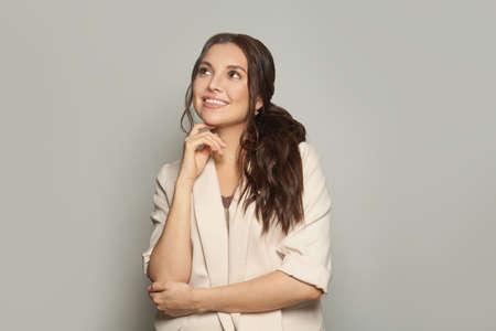 Portrait of happy clever businesswoman