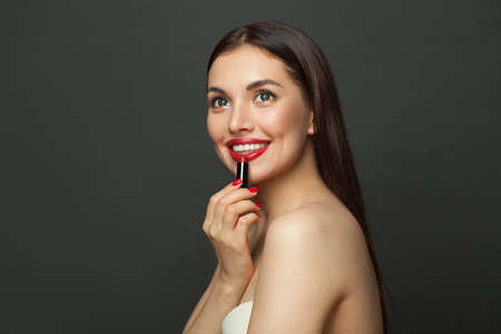 Young beautiful happy woman with red lips makeup and lipstick 免版税图像