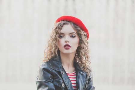Perfect young woman in red beret outdoor portrait