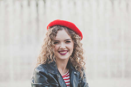 Happy young woman in red beret portrait 免版税图像