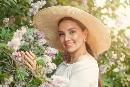 Happy beautiful woman with flowers outdoors 免版税图像