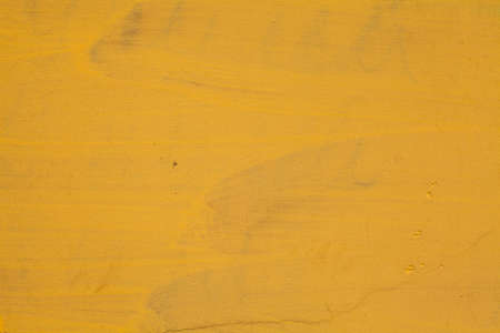 Abstract bright yellow grunge decorative stucco wall create from plaster cement material