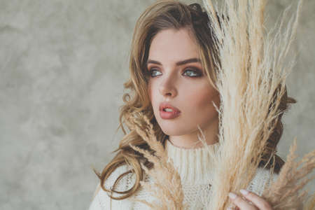 Attractive female model woman with makeup, face close up portrait