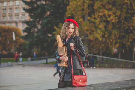 Fashion model woman with red handbag outdoor portrait