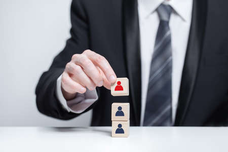 Business leader concept with red person on wooden blocks