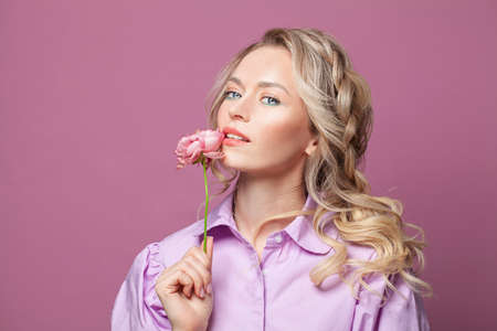 Confident friendly attractive woman on pink background