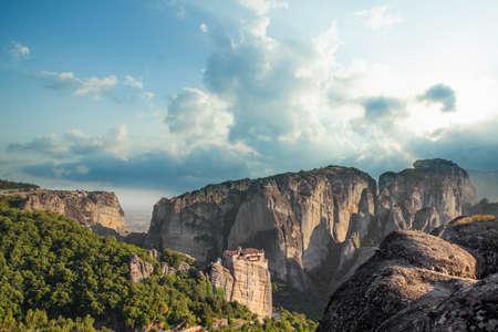 Monastery, rocks and summer sky clouds in Meteora valley, Greece