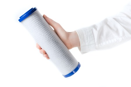cleanse: water filter cartridge in human hand isolated on white