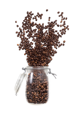 filled out: coffee jar filled beans. fly out, boom on white background isolated Stock Photo
