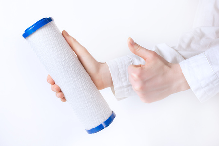 water filter cartridge in humans two hands