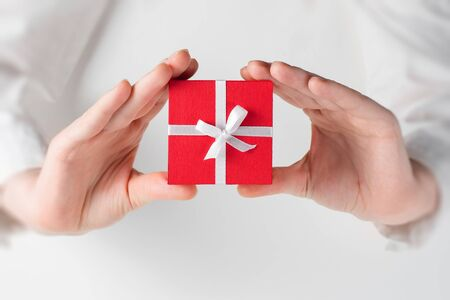 love shape: Hands holding box for a gift on white Stock Photo