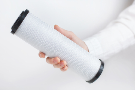 elbow white sleeve: water filter cartridges in human hands on white