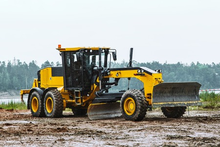earth moving: Road grader - heavy earth moving on dirty ground