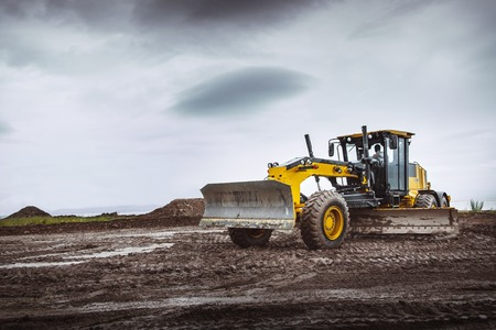 grader: Road grader - heavy earth moving on dirty ground
