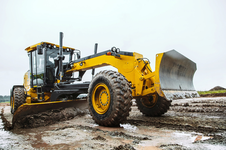 excavator: Road grader - heavy earth moving on dirty ground