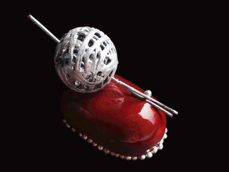 Red chocolate berry dessert with silver wool ball decoration and sprinkles on black background Stock Photo