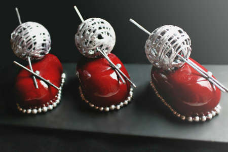 Red christmas berry desserts with silver wool ball decoration and brownie