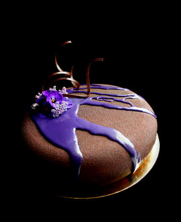 Chocolate textured spring flower cake with purple mirror glaze cover and chocolate spiral decoration