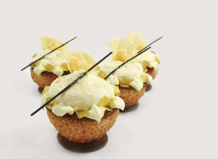 Cream puff profiteroles with lemon jelly and white rose petals