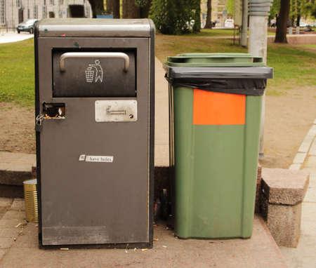 Urban public garbage trash cans on a street