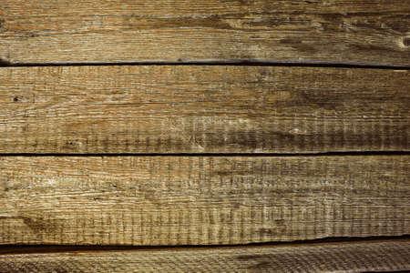 Fondo de superficie de mesa de madera antigua con textura de madera y huecos entre tablas