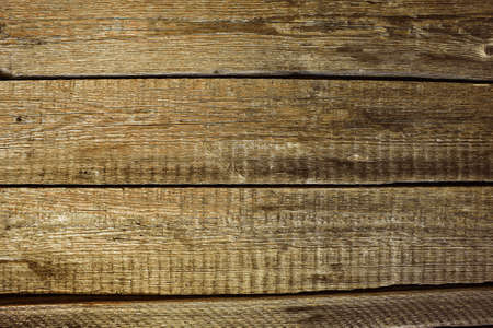 Old wooden table surface background with wood texture and gaps between planks