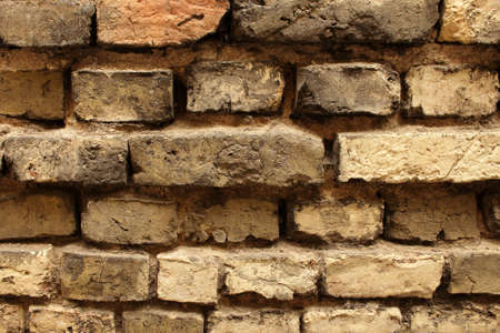 Old textured exterior brick wall uneven surface background