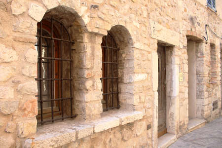Brick wall windows with bars, ancient jail museum architecture Stock Photo - 130099411
