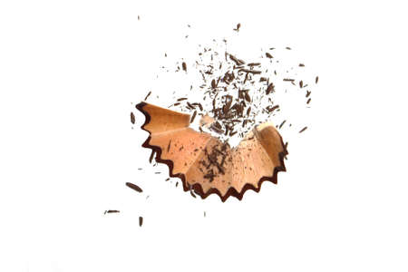 Coloring pencil shavings with small particles on white background