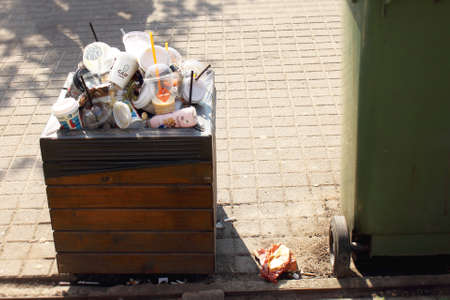 Vilnius Lithuania - 04 22 2019: Trash bin overfilled with plastic and paper cups Editöryel