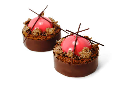 Red strawberry sphere and brownie dessert with dark chocolate jelly caviar and chocolate border Stockfoto