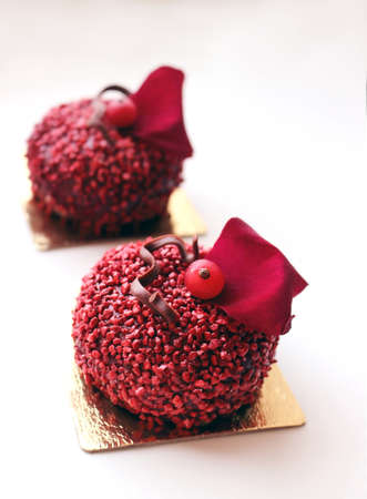 Red textured sugar desserts with red currant berry and red rose petal on white background Stock fotó