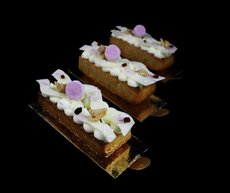 Coconut financier dessert with dried cranberries, white chocolate and purple meringues