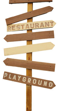 Wooden plank directional road sign with empty pointing arrows and restaurant and playground writings