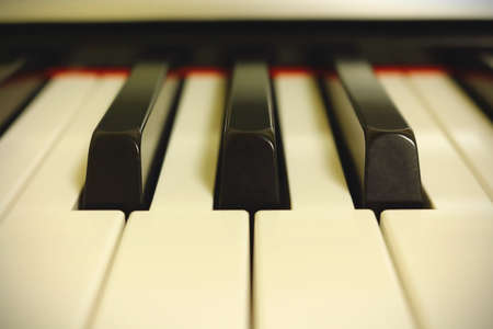 Light piano keyboard close up in bright white light Stock Photo