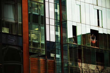 Modern glass building with reflections in glass windows Stock Photo
