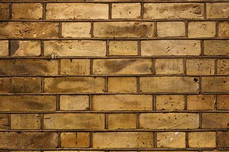 Yellow big brick wall dirty surface backdrop