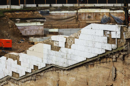 White tiled diagonal wall on messy construction site