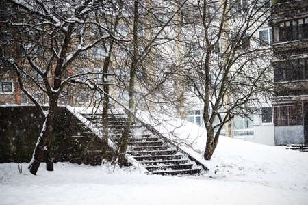 Winter urban landscape stairs in empty Vilnius city yard