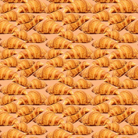 Baked golden brown croissant seamless pattern background