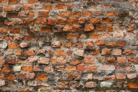 Red old crumbling brick wall textured background 版權商用圖片